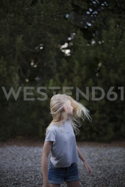 Girl standing outdoors in Ornahusen, Sweden - FOLF10263
