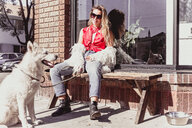 Young woman with pet dog at shopfront - ISF20126