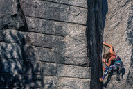 Young female rock climber climbing rock face, Smoke Bluffs, Squamish, British Columbia, Canada - ISF20192