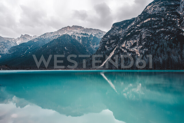 Landscape with turquoise lake and snow capped mountains, Dolomites, Italy - ISF20201