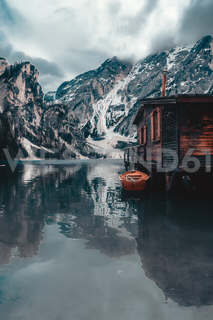Landscape with lakeside log cabin and snow capped mountains, Dolomites, Italy - ISF20204