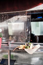 Food served through window of food truck - ISF20279