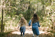 Sisters running in forest - ISF20306