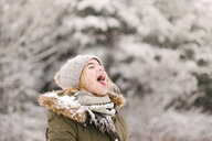 Girl with mouth open waiting for snow - ISF20330