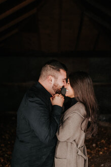 Happy couple enjoying romance and hugs - ISF20372