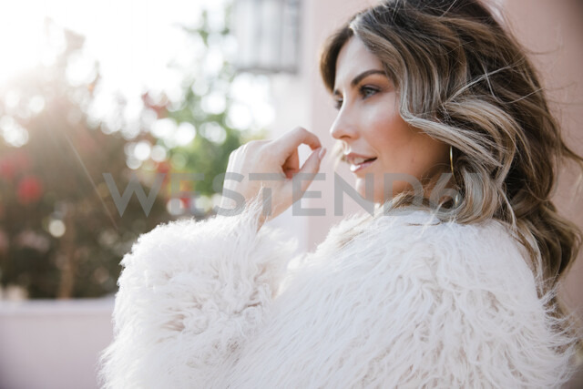 Fashionable woman in fake fur coat - ISF20384