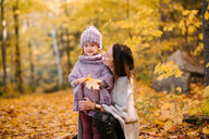 Mother and daughter in forest - ISF20390