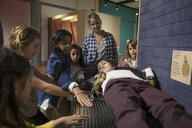 Mother and children at bed of nails exhibit in science center - HEROF05630