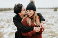Couple hugging in snowy landscape, Georgetown, Canada - ISF20495