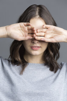 Portrait of brunette young woman, see no evil - VGF00194