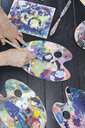 Cropped image of senior woman using palettes while painting - ASTF02315