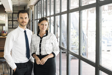 Portrait of two colleagues in front of window - SBOF01603