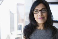 Portrait confident businesswoman wearing eyeglasses - HEROF05668
