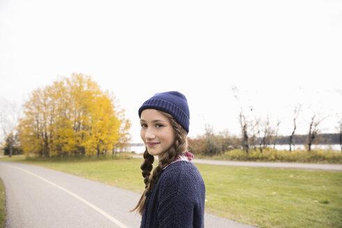 Portrait confident tween girl in autumn park - HEROF05794