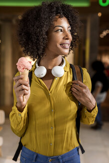 Portrait of smiling woman with ice cream cone - MAUF02360