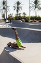Barechested muscular man exercising in a skatepark - MAUF02387