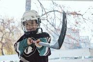 Portrait of a boy in ice hockey gear - ZEDF01797