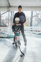 Father and son on the ice rink, boy playing ice hockey - ZEDF01800