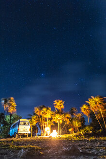 Mexico, Yucatan, Quintana Roo, Tulum, camper van on the beach at night with palm trees - MMAF00776
