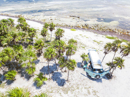 Mexico, Yucatan, Quintana Roo, Tulum, drone view of camper van on the beach with palm trees - MMAF00779