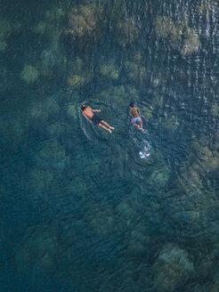 Asian boys  snorkeling in ocean - KNTF02610