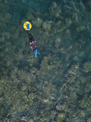 Freedivers with buoy in ocean - KNTF02613