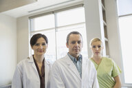 Portrait of confident dentists and assistant - HEROF06464