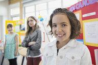 Portrait of confident school girl at science fair - HEROF06521