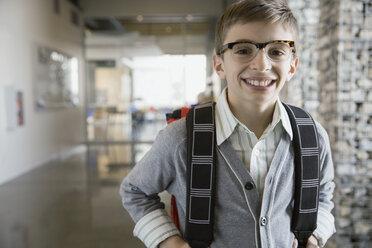Portrait of confident school boy in corridor - HEROF06524