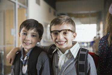 Portrait of confident school boys in corridor - HEROF06527