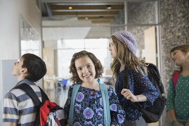 Portrait of confident school girl in corridor - HEROF06536