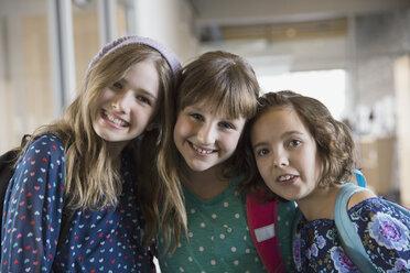 Portrait of confident school girls in corridor - HEROF06542