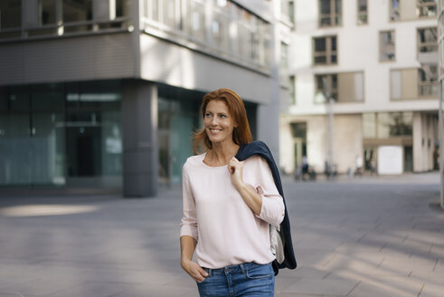 Smiling businesswoman outdoors in the city - JOSF02916