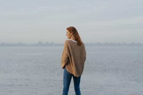 Germany, Hamburg, woman standing at the Elbe shore - JOSF02982
