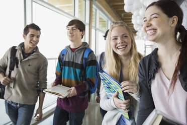 High school students laughing in corridor - HEROF06716