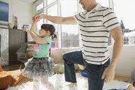 Father spinning daughter in tutu - HEROF06731