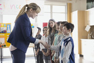 Elementary teacher handshaking with students at science fair - HEROF06761