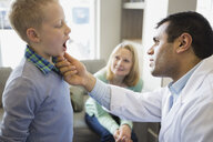 Dentist looking into boys mouth - HEROF06914