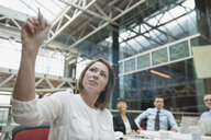 Businesswoman with dry erase marker leading meeting in conference room - HEROF07528