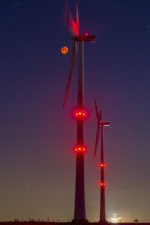 Wind wheels in front of blood moon at night - FRF00809