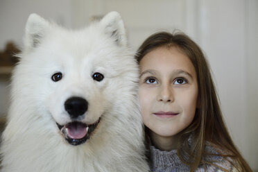 Portrait of girl with her white dog - ECPF00283