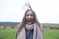Portrait of laughing girl with blowing hair in winter - ECPF00298