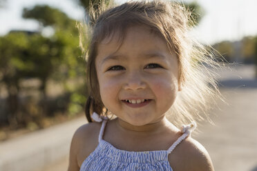 Portrait of happy little girl outdoors - MAUF02427