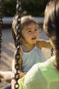 Portrait of a girl with her mother on a playground - MAUF02430