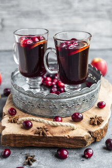 Two glasses of Mulled Wine with cranberries, orange slices and star anise on tray - SARF04057