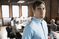 Portrait of confident businessman in office - HEROF07745