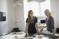 Portrait of confident businesswomen in office - HEROF07823