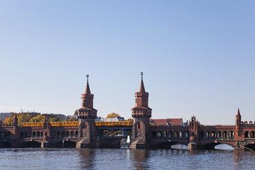 Germany, Berlin-Kreuzberg, view to Oberbaum Bridge with underground train - GWF05814