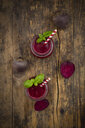 Two glasses of beet root smoothie garnished with basil leaves - LVF07689