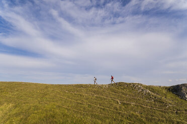 Italy, Monte Nerone, two men hiking on top of a mountain in summer - WPEF01296